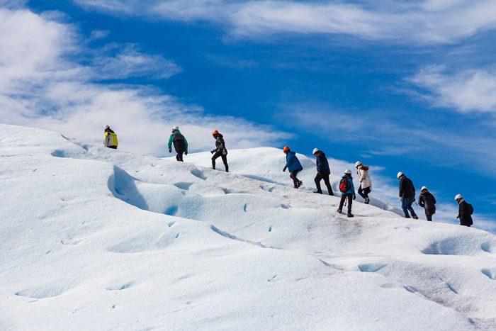 people-walking-on-a-glacier-adventure-group-perito-moreno